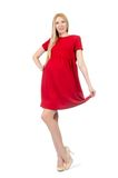 Pretty pregnant woman in red dress isolated on the Royalty Free Stock Photo