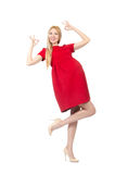Pretty pregnant woman in red dress isolated on the Stock Image