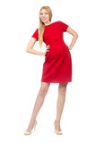 Pretty pregnant woman in red dress isolated on Stock Photo