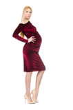 Pretty pregnant woman in red dress isolated on Royalty Free Stock Photo
