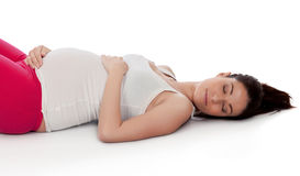 Pretty pregnant woman resting in her training Royalty Free Stock Image