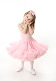 Pretty preschool ballerina. Portrait of an adorable preschool age girl playing dress up wearing a ballet tutu, isolated on white Stock Photography