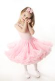 Pretty preschool ballerina. Portrait of an adorable preschool age girl playing dress up wearing a ballet tutu, isolated on white Stock Image