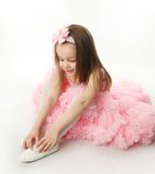 Pretty preschool ballerina. Portrait of an adorable preschool age girl playing dress up wearing a ballet tutu, isolated on white Royalty Free Stock Photography