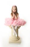 Pretty preschool ballerina. Portrait of an adorable preschool age girl playing dress up wearing a ballet tutu, isolated on white Royalty Free Stock Image