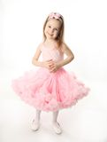 Pretty preschool ballerina. Portrait of an adorable preschool age girl playing dress up wearing a ballet tutu, isolated on white Stock Photos
