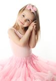 Pretty preschool ballerina. Portrait of an adorable preschool age girl playing dress up wearing a ballet tutu, isolated on white Royalty Free Stock Photos