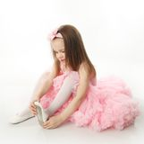 Pretty preschool ballerina. Portrait of an adorable preschool age girl playing dress up wearing a ballet tutu, isolated on white Royalty Free Stock Images