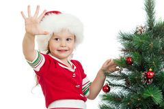 Pretty preschool child decorating Christmas tree Stock Photography