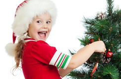 Pretty preschool child decorating Christmas tree Royalty Free Stock Photos