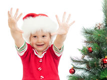Pretty preschool child near Christmas tree Royalty Free Stock Images