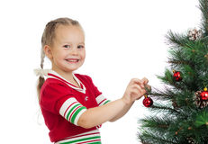 Pretty preschool girl decorating Christmas tree Royalty Free Stock Photos