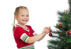 Pretty preschool girl decorating Christmas tree Royalty Free Stock Photos