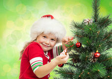 Pretty preschool girl decorating Christmas tree Royalty Free Stock Photo