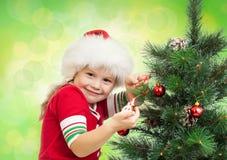 Pretty Preschool Girl Decorating Christmas Tree Royalty Free Stock Photo