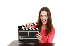 Pretty preteen brunette girl actor. Beautiful young teen girl holding an actor's slate smiling Stock Image