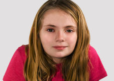 Pretty preteen girl. Soft focus portrait of pretty preteen girl smiling at camera Royalty Free Stock Photo