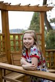 Pretty Preteen Girl #2. Image of a pretty yooung lady on a cedar deck Stock Image