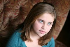 Pretty preteen girl. Beautiful young girl looking out in natural light Stock Photo