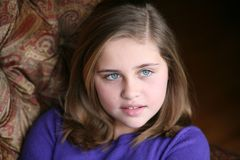 Pretty preteen girl. Beautiful young girl looking out in natural light Royalty Free Stock Images