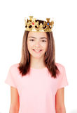 Pretty preteen girl with a crown. Isolated on a white background Stock Photography