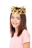 Pretty preteen girl with a crown. Isolated on a white background Stock Photos