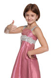 Pretty preteen girl holds her thumb up. A pretty preteen girl holds her thumb up on the white background Royalty Free Stock Photo