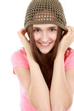 Pretty preteen girl in knit hat. Close up of tween girl smiling in hat Stock Image