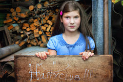 Pretty preteen girl play in the country yard Stock Images