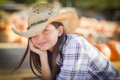 Pretty Preteen Girl Portrait at the Pumpkin Patch. Pretty Preteen Girl Wearing Cowboy Hat Portrait at the Pumpkin Patch in a Rustic Setting Stock Photos