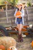 Pretty Preteen Girl Portrait at the Pumpkin Patch. Preteen Girl Wearing Cowboy Hat Portrait at the Pumpkin Patch in a Rustic Setting Stock Photo