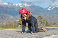 Pretty preteen girl on roller skates in helmet. A pretty preteen girl on roller skates in helmet Royalty Free Stock Photos