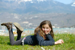 Pretty preteen is lying in the green grass. A pretty preteen is lying in the green grass, in the spring Stock Photos