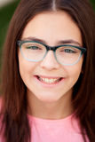 Pretty preteenager girl with glasses outside Stock Image