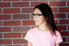 Pretty preteenager girl with glasses outside Stock Images