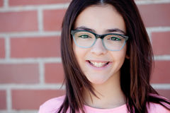 Pretty preteenager girl with glasses outside Royalty Free Stock Photos