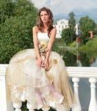 Pretty princess dreams of future. Pretty princess in white-golden gown dreams of future Royalty Free Stock Photo