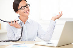 Pretty professional employee speaking on the phone Stock Image