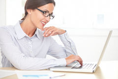 Pretty professional secretary using the laptop Royalty Free Stock Photography