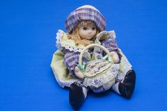 A pretty rag doll with colourful hat and shopping basket stock image
