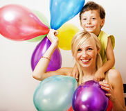 Pretty real family with color balloons on white background, blon Royalty Free Stock Image
