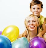 Pretty real family with color balloons on white background, blon Royalty Free Stock Photos