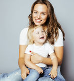 Pretty real fashion mother with cute blond little Royalty Free Stock Photography