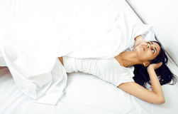 Pretty real mulatto brunette woman in bed, cant Stock Photo