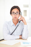Pretty receptionist calling on the phone Stock Photos