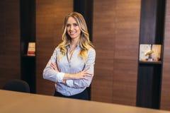 Pretty receptionist at work. Picture of pretty receptionist at work stock photo