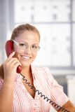 Pretty receptionist working talking on phone Stock Images