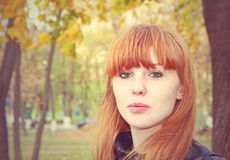 Pretty red hair girl looks at camera.Tonal correction. Royalty Free Stock Photography