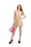 Pretty red hair girl in summer dress holding bags Stock Images