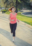 Pretty red hair woman running in the park Royalty Free Stock Photo